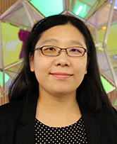 Xue Jin in front of an artwork installation in Johnson Hall