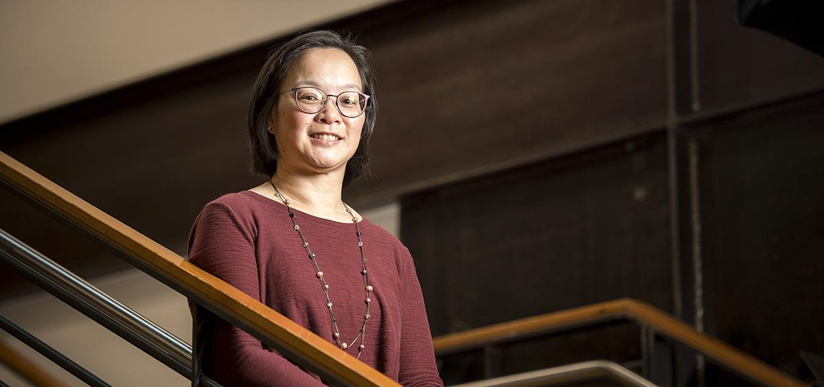 Judy Liu sits on the stairs in Kearney Hall