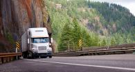 Semi travels around a curve on a highway in the Columbia River Gorge.